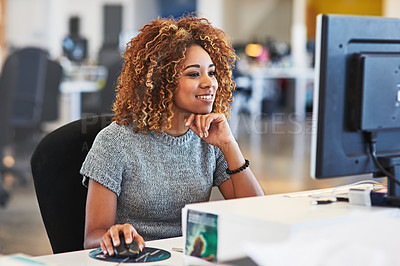 Buy stock photo Shot of a young businesswoman using a computer in an office