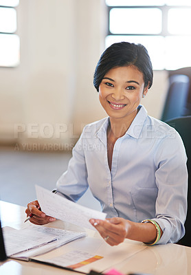 Buy stock photo Shot of a young businesswoman working in the office