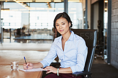 Buy stock photo Portrait of an ambitious young businesswoman working in the office