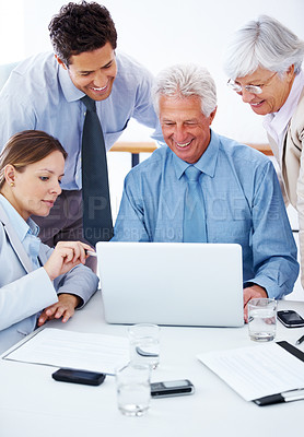 Buy stock photo Portrait of a young woman explaining a job to her team from a laptop computer