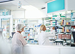 Taking care of her customer's prescriptions and healthcare needs