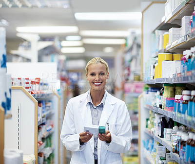 Buy stock photo Cropped portrait of a female pharmacist working in a chemist