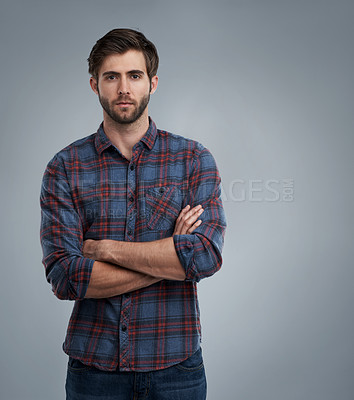 Buy stock photo Studio portrait of a young man against a grey background