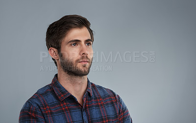 Buy stock photo Studio shot of a young man against a grey background