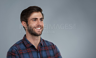 Buy stock photo Studio shot of a smiling young man against a grey background