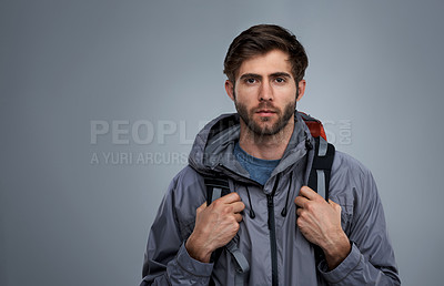 Buy stock photo Studio portrait of a young backpacker against a gray background