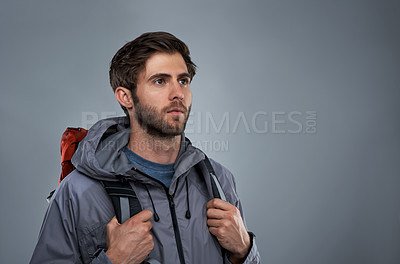 Buy stock photo Studio shot of a young backpacker against a gray background