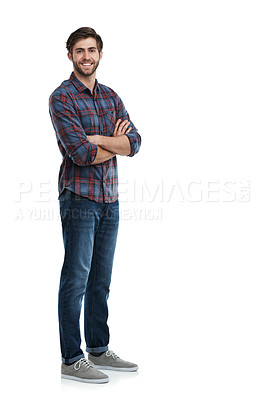 Buy stock photo Studio portrait of a smiling young man standing with his arms crossed isolated on white