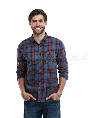 Buy stock photo Studio portrait of a smiling young man standing with his hands in his pockets isolated on white