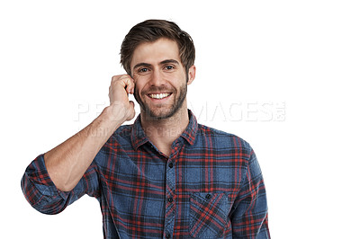 Buy stock photo Studio portrait of a young man talking on a cellphone isolated on white