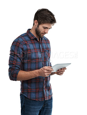 Buy stock photo Studio shot of a young man using a cellphone isolated on white