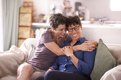 Buy stock photo Portrait of an affectionate couple relaxing on the sofa at home