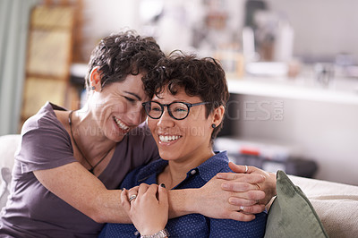 Buy stock photo Shot of an affectionate couple relaxing on the sofa at home