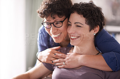 Buy stock photo Shot of an affectionate couple spending time together at home