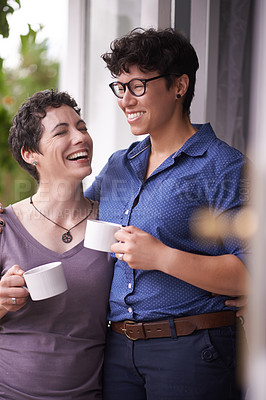 Buy stock photo Shot of a happy couple enjoying a leisurely cup of coffee together at home