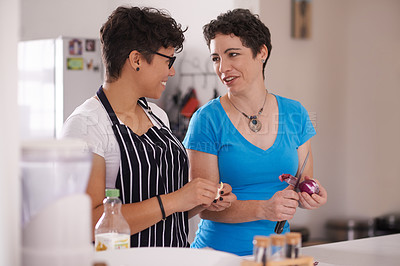 Buy stock photo Cropped shot of a mature couple cooking in the kitchen