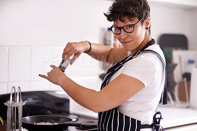 Buy stock photo Cropped portrait of a mature woman cooking in the kitchen