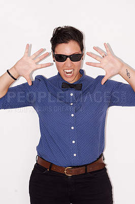 Buy stock photo Studio shot of an expressive woman wearing sunglasses
