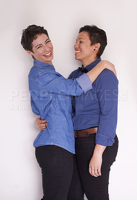 Buy stock photo Studio portrait of a happy couple sharing an affectionate moment