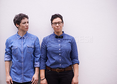 Buy stock photo Studio shot of two women dressed in trendy fashion