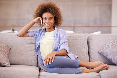 Buy stock photo Portrait of a young woman relaxing on the sofa at home
