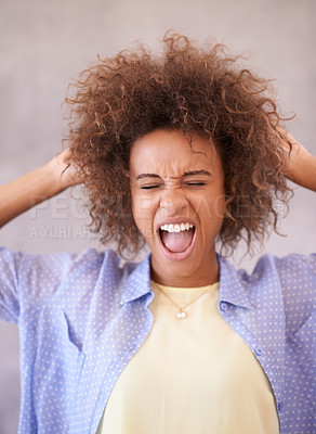Buy stock photo Studio shot of a young woman pulling faces