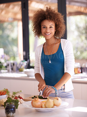 Buy stock photo Shot of a young woman preparing a meal at home