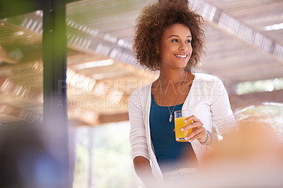 Buy stock photo Shot of a young woman having a glass of juice