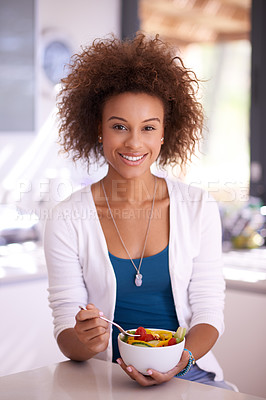 Buy stock photo Shot of a young woman eating a bowl of salad at home