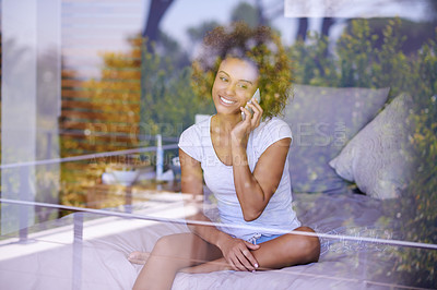 Buy stock photo Shot of a young woman making a call on her phone in the morning