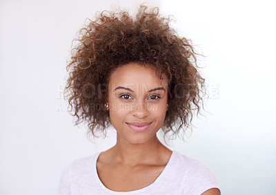 Buy stock photo Portrait of an attractive young woman against a white background