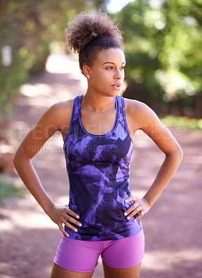 Buy stock photo Shot of an attractive young woman out for a run
