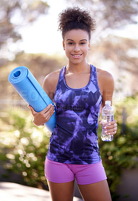 Buy stock photo Portrait of a young woman in exercise clothes holding a yoga mat while standing outdoors
