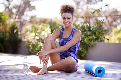Buy stock photo Portrait of an attractive young woman in exercise clothes sitting outdoors