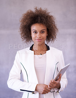 Buy stock photo Portrait of a young businesswoman holding a digital tablet in an office