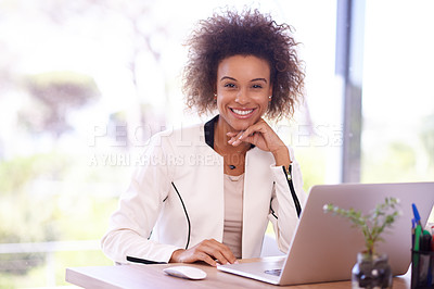 Buy stock photo Portrait of a young businesswoman using a laptop in an office