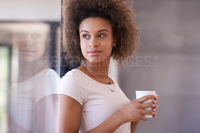 Buy stock photo Shot of a young businesswoman drinking a beverage in an office