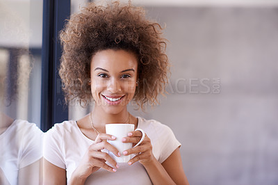 Buy stock photo Portrait of a young businesswoman drinking a beverage in an office