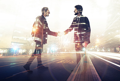 Buy stock photo Multiple exposure shot of a two businessmen shaking hands superimposed on an urban highway