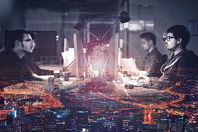 Buy stock photo Mutiple exposure shot of developers working late superimposed on a urban skyline at night