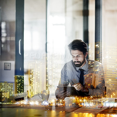 Buy stock photo Multiple exposure shot of a young businessman working in an office superimposed on a city at night