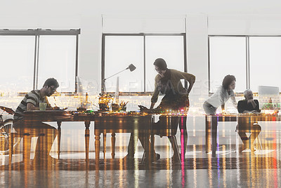 Buy stock photo Multiple exposure shot of colleagues working in a modern office superimposed over a city background