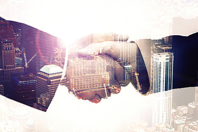 Buy stock photo Multiple exposure shot of businesspeople shaking hands superimposed against a city background