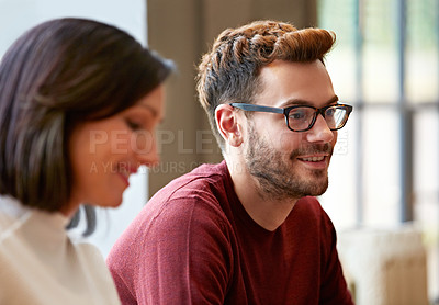 Buy stock photo Shot of a smiling young couple at home