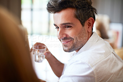 Buy stock photo Shot of a two people talking together at the dinner table