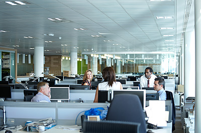 Buy stock photo Shot of a group of businesspeople talking in the office