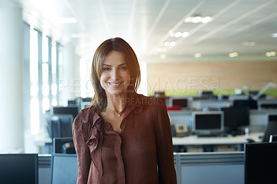 Buy stock photo Portrait of a smiling woman standing in an office