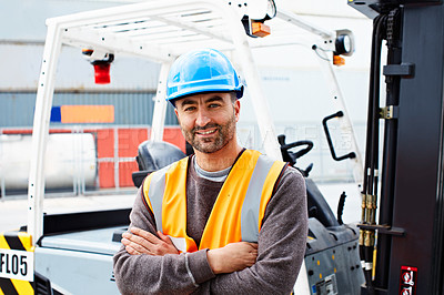 Buy stock photo Portrait of a forklift operator working on a large commercial dock