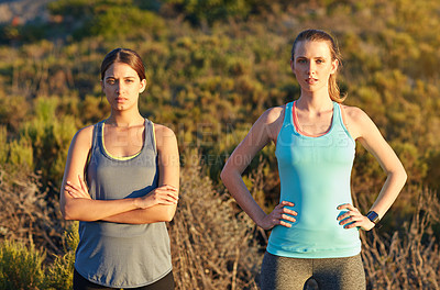 Buy stock photo Portrait of two dedicated young woman out for a cross country run