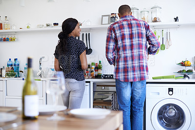 Buy stock photo Shot of a young couple preparing dinner in their kitchen